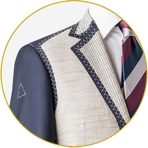On better men's suits, there is layer of canvas between the fabric and the lining which allows the jacket to conform to your body. On cheap ones, the fabric and  lining are fused.