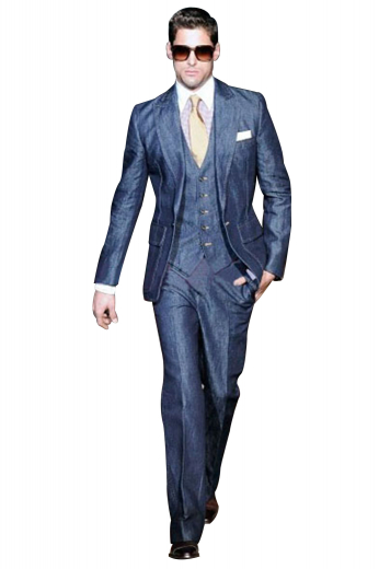 A three-piece work of art put together by a v-neck single breasted five button vest, a slim cut single breasted one button suit jacket with peak lapels, and lastly a pair of impeccable high waisted reverse pleat suit pants.