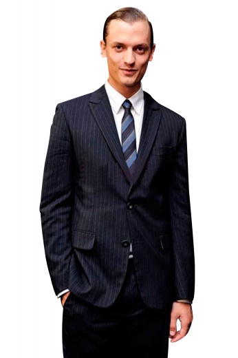 A bespoke slim cut men's suit made up of a single breasted two button suit jacket with pressed high peak lapels, paired with a pair of flat front elegant suit pants.