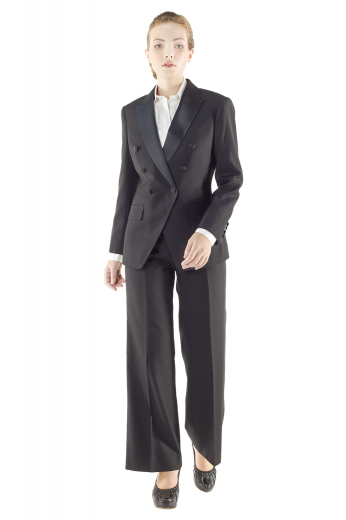 Classy black tuxedo jackets handmade with wool and or cashmere. These double breasted tux jackets boast six fabric covered front buttons, one to close. They flash satin facing peak lapels, V cut bottoms, flapped lower pockets and hand molded shoulders.