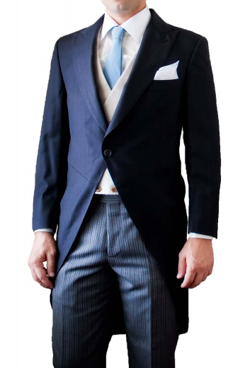 A made to measure single breasted one button rolled peak lapel suit jacket with a high gorge, paired with matching navy flat front pants with an extended three-point closure waistband with side adjustable tabs.