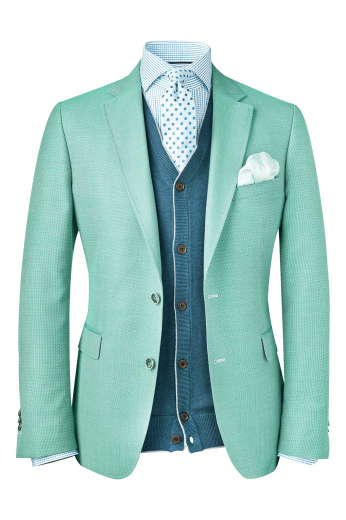A handmade wool and cashmere blend blazer with a single-breasted, two button high notch lapel design, custom tailored elegantly.