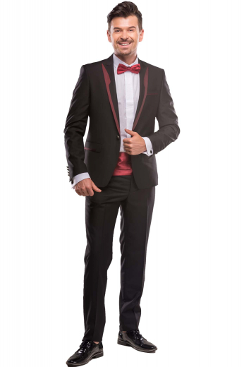 A custom tailored men's slim cut single breasted suit jacket with peak lapels with satin facings and a center vent, paired with an elegant pair of slim fit flat front pants.