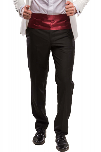 A pair of made to measure slim fit flat front pants with slash pockets, carefully tailored belt loops, a two point button and hook closure waistband, and hand-sewn cuff hems.