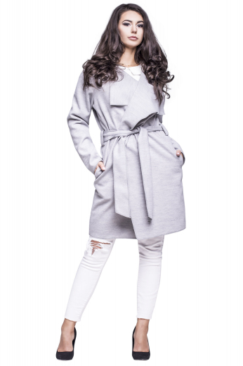 This gorgeously hand sewn womens custom made light grey wool overcoat comes from the range of trendy and affordable handmade garments at My Custom Tailor. This womens tailor made loose fit topcoat has a high gorge, comfortable belt loops, and a sash for closure. This womens handmade knee length light grey overcoat also features 3 intricately sewn hand moulded shoulders. You can wear this womens custom made wool overcoat with womens bespoke slim fit dress pants to flaunt a stylish look wherever you go.