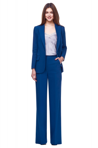 Stunning party wear formal pant suits with sexy jackets sporting one front closure button, two flapped lower pockets and four inches wide lapels, and mesmerizing custom pants incorporating slash pockets on the front, neatly hand sewn hems and cuffs and zipper fly with buttoned waistband for secure front closure.