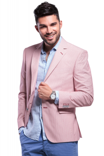 This super classy mens tailor made salmon jacket in cashmere wool is a stunning casual that you can team up with mens bespoke slim fit dress pants for a semi-formal work look. This mens custom made salmon blazer has 2 front close buttons, 2 3 inch wide notch lapels with 1 boutonniere on the left lapel, a center vent, 1 upper welt pocket, and 2 lower pockets with flaps. You can buy this mens handmade cashmere blazer at My Custom Tailor at super affordable rates.
