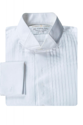 This mens handmade white tuxedo shirt in supima cotton is a classic garment that you can wear at weddings and corporate parties. This mens made to order slim fit tuxedo shirt features a wing tip collar, 2 squared edge french cuffs, and a stunning placket front. You can wear this mens handmade cotton tuxedo shirt with mens tailor made tuxedo pants and mens handmade dinner jackets for a classy look. Buy this mens custom made slim fit white tux shirt at My Custom Tailor for a sophisticated party look.