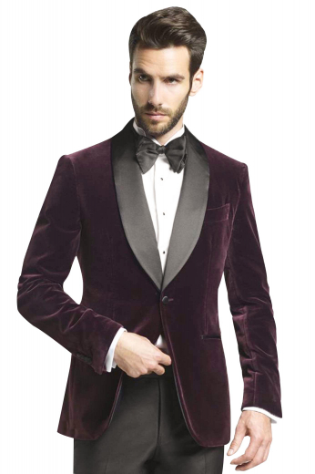 This mens tailor made velvet tux features a bespoke dinner jacket in wine and custom made grey dress pants. The mens handmade slim fit jacket has a shawl collar with grey satin facing lapels, 2 satin piped lower pockets, 1 upper welt pocket, and 1 front close button. The mens bespoke slim fit dress pants have 2 front slash pockets, 2 back pockets, a zip fly, and a 2 point button and hook closure. Buy this stunning mens handmade slim fit dinner suit at My Custom tailor to flaunt a dapper look at weddings and corporate parties.