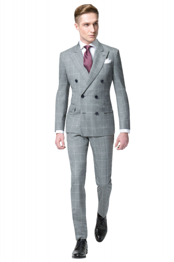 Iconic mens handmade double breasted grey suit in 150s wool. This mens tailor made plaid suit features a slim fit double breasted jacket with 6 front buttons, 2 to close and bespoke plaid dress pants with a high waist. The mens custom made plaid dinner jacket features peak lapels with 1 boutonniere on the left lapel, a center vent, 2 lower flap pockets, and 1 upper welt pocket. The mens tailor made slim fit dress pants have 2 front slash pockets, 2 back pockets, a zip fly, and a 2 point button and hook closure.