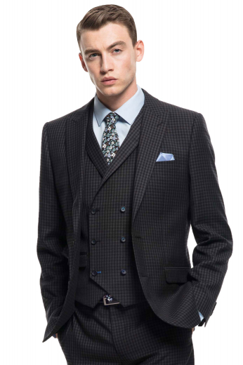 A premium men's three-piece check suit made up of a pair of custom hand-tailored slim fit flat fronts with a two-point hook closures waistband, a  double breasted six button matching vest, and completed by a dashing slim cut single breasted suit jacket.