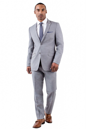A men's made to measure slim cut single breasted suit jacket with fine detailing to complete a dapper look, this men's suit jacket features rolled peak lapels, an upper welt pocket, and slanted lower pockets.