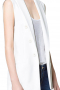 Classy womens handmade cotton vest in ivory. A perfect formal that you can wear to interviews and meetings. This tailor made cotton vest for women has a slim cut fitting further boosted with the inclusion of a cloth back with an adjustable buckle so that you can drape this womens slim fit vest around your waist as tightly as you want. This womens bespoke vest with a hand sewn peak lapel collar also features 6 front buttons. Take a bite at luxury with the inclusion of this stunner in your summer wardrobe of corporate wear.