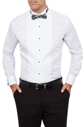 This iconic mens handmade tuxedo shirt in white is perfect for the wedding season. Whether it's a cocktail event or a reception party, this mens bespoke tuxedo shirt will keep you stylish and comfortable. It features a stellar wing tip collar and a placket front adorned with black buttons to close. This mens tailor made tuxedo shirt in cotton has a slim cut fit with squared edge French cuffs and is an invaluable addition to upgrade your wardrobe of premium quality tuxedos at affordable rates.