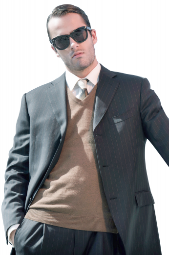 This stylish mens bespoke alpaca wool grey blazer with white vertical stripes is a perfect option for formal garments you can wear to work daily. It has a classy slim cut fit that looks even better with the incorporation of 3 front closure buttons and 2 notch lapels with a high gorge. With 2 lower flap pockets and 1 upper welt pocket, this single breasted mens custom blazer can also have hand stitched edges of the pockets and lapels.