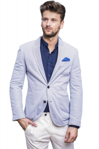 Flaunt a dapper look at work with this double breasted mens handmade grey blazer made with wool. Coming from the premium section of mens bespoke garments at My Custom Tailor, this made to order blazer puts on display slim ruled peak lapels, two lower pockets with flaps, and one upper welt pocket. Designed with rare specialities, the edges of the lapels and pockets can be neatly hand stitched upon request. Order online to include this slim fit single breasted blazer in your list of corporate wears this season.