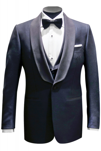 Ideal for interviews, black ties, and meetings, this stellar made to measure mens grey jacket in wool and linen puts to display elegant hand sewn satin facing shawl collar. It comes from the premium range at My Custom Tailor and can be ordered online. This bespoke slim fit blazer is single breasted, provided with a one button front closure, an upper welt pocket, and two elegantly sewn double piped lower pockets. It is an ultra-soft and ultra-stylish blazer that can be worn with mens bespoke shirts and slim fit pants.