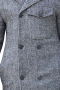 This men's custom made grey colored coat is tailor made in a fine wool and tweed and cut to a slim fit, featuring a double breasted button closure, slanted pockets, and edge stitched lapels. It is a classic winter coat, sure to become a staple in your everyday wardrobe!
