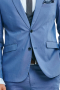 This men's pant  suit is tailor made in a fine wool blend and cut to a slim fit, featuring single breasted button closures, notch lapels and slash pockets. It is perfect for all formal occasions, in a pastel blue color.