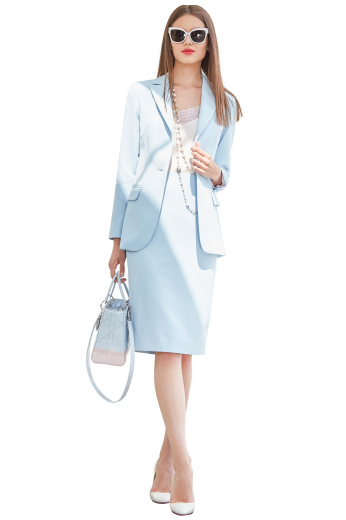 This skirt suit adds instant elegance to your outfit. It is custom made with a classic single breasted button closure and a modest slit.