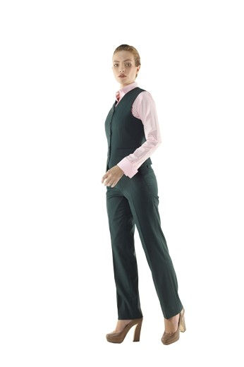 Beautifully hand sewn bespoke vests with angled V cut bottoms and five matching front buttons to close. These made to measure dark green V neck vests with handmade slanted flapped lower pockets look bewitching with matching custom pants and slim cut shirts.