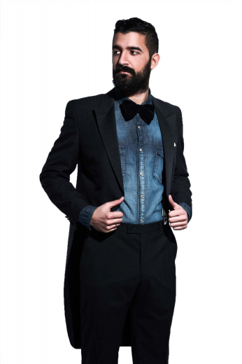 Style no.15645 - A men's handmade English mink tailed suit for the elegant modern man. This custom tailored suit is made up of a tailor made medium gorge long suit jacket with peak lapels, an upper welt pocket, and hand molded shoulders, paired with classy made to measure slim fit flat front suit pants.