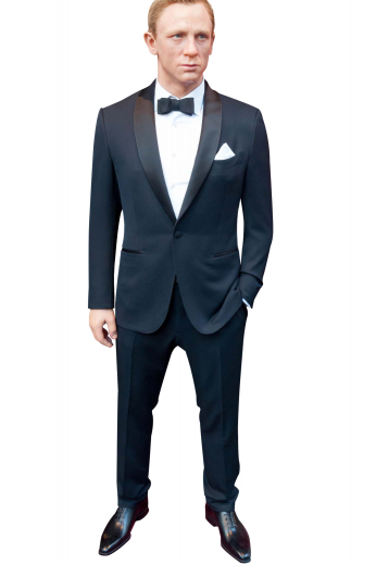 This mens custom made 120s wool black tuxedo - featuring a bespoke slim fit tuxedo jacket and handmade dress pants - is ideal for weddings and formal events. The mens custom made jacket has a shawl collar with 3-inch-wide satin-facing lapels, 1 angled upper welt pocket, 2 double piped lower pockets, hand moulded shoulders, and 1 front close button. The mens bespoke slim fit tuxedo pants have hand sewn cuff hems at the bottom, satin piping on the side seam, 2 front slash pockets, a 2 point button and hook closure, and a zip fly.