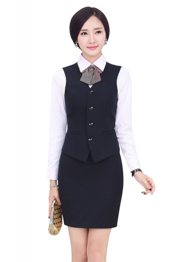 Style no.16166 - Womens handmade dark Navy skirt suit in twill cotton. An ideal office wear with an elegantly stitched custom pencil skirt and a handmade single breasted vest. The womens custom made pencil skirt with a back center vent and a back zipper for closure provides all day comfort with a flat front that sits right above the knees. The womens handmade slim fit vest features a V-neck, 4 front closure buttons, and 2 lower welted pockets. The womens made to order cotton vest also features a back with an adjustable buckle for perfect fitting.