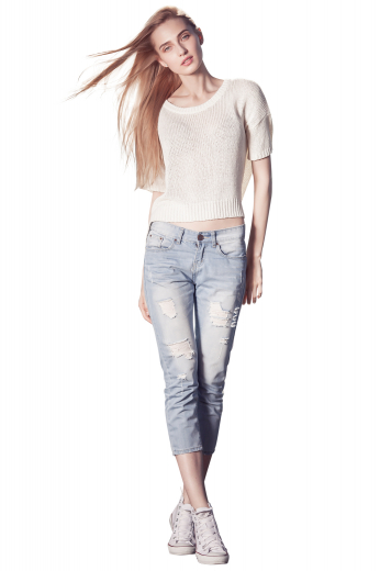Style no.16974 - A flattering pair of woman made to measure light washed denim pants. This women's pant is tailor made in a denim blend. It features extended belt hoops, hitting just at the calf and distressed detailing.