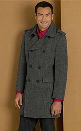 Dated look British contemporary cut four buttons to use double breasted mid thigh car coat with folded over epaulettes and folded back lapels that close at the top button