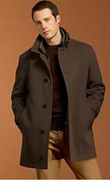 Collared five spaced button with last button on the hem trimmed with slanted double piped lower pockets in this casual below hip length car coat